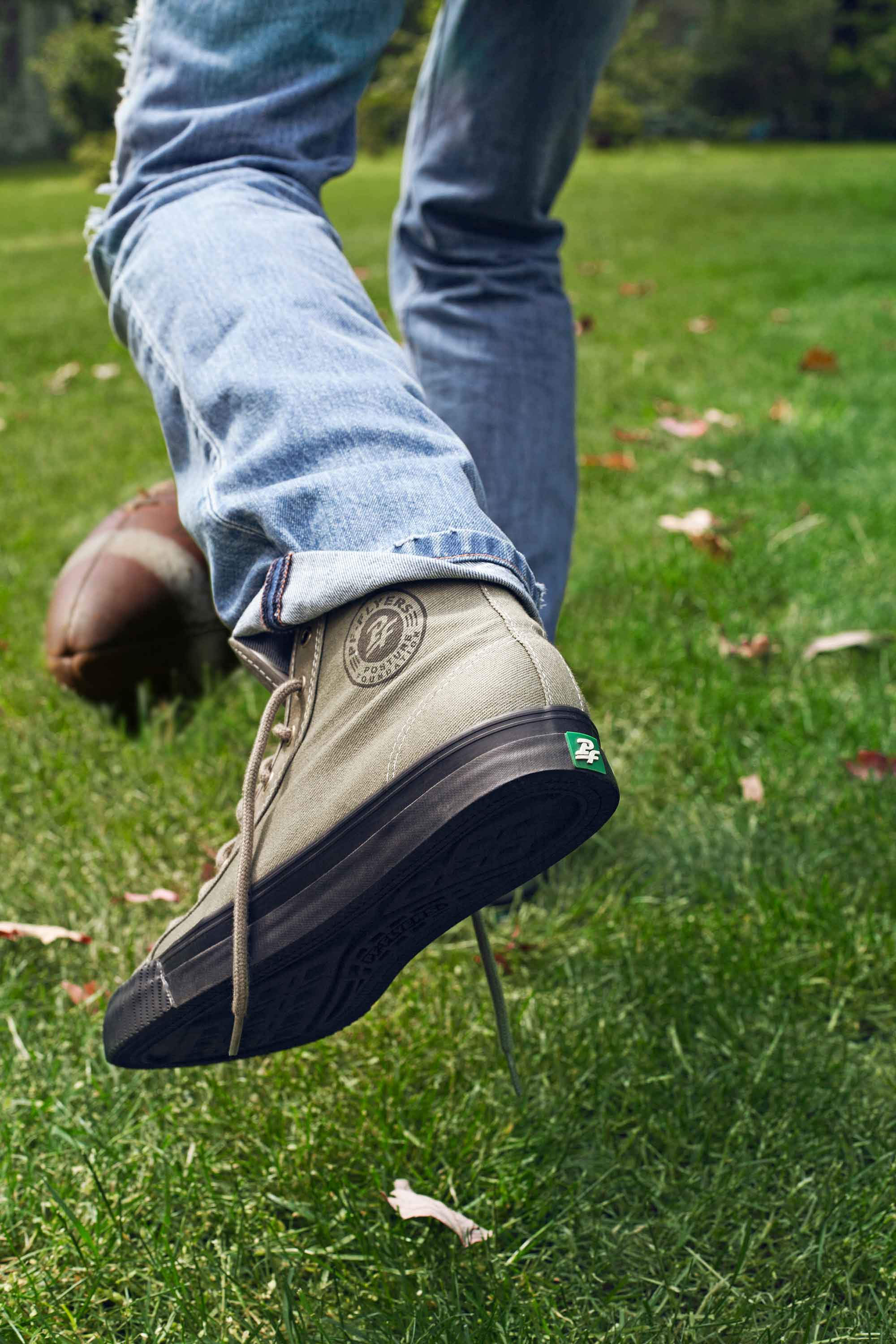 image of PF Flyers shoes on feet kicking ball